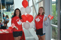VOLUNTEERS Lauren Kamer and Kaitlyn Gallant greet visitors at the Canada Day celebrations held in the Alder Street recreation centre in Orangeville on July 1.  The afternoon featured a variety of events, including an indoor playground for the kids and an agility dog demonstration.