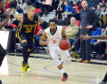 Orangeville A's point guard, Anthony Harris, drives past a London Lightning player during the first quarter of Wednesday (Jan. 4) night's NBL game at the Athlete Institute. The A's came out on top leaving the court with a 121-113 win over the visitors.