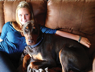 Chantel Welsh pictured with her three-year-old Doberman Diesel, who was shot and killed back in January 2016.