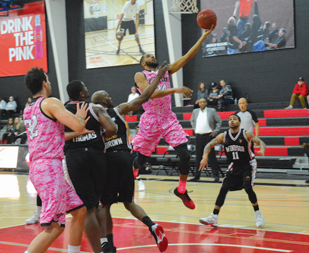 Orangville A's forward, Rahlir Hollis-Jefferson lays up a shot during the second quarter of Saturday (Feb. 11) night's game against the Windsor Express. The A's, wearing distinctive pink uniforms for the team's Pink Night in support of breast cancer for the evening's theme, lost 135-134 when the game went into overtime.