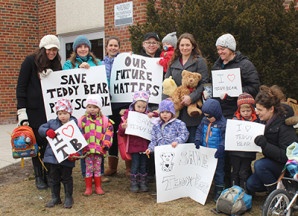 DOZENS OF LOCAL RESIDENTS gathered outside Orangeville District Secondary School on Tuesday (Feb. 21) to show their support for the local high school's Teddy Bear Playschool program, which is set to be shut down at the end of the current school year following three decades of programming in the community.