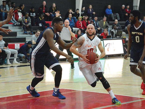 Orangeville A's guard, Rico DiLoreto drives for the net around a Saint John Riptide defender during Wednesday's (Apr. 5) NBLC game at the Athlete Institue. The A's took a loss in this then returned on Saturday night for a win over the Cape Breton Highlanders.