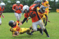 Orangeville Outlaws Bantam tackle, Joey Santarossa, flattens a Guelph Gryphons player during the second half of Sunday's (July 16) game at Westside Secondary School in Orangeville. The Outlaws stepped it up in the second half to close the score gap but had to settle for a 47-36 loss.