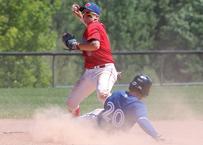 The West Division All-star second baseman Benjamin Davies makes an out against Aaron Giroux of the East Divsion and looks for the throw to first to make a double play during the senior division All-Star game contest July 8, in Midland.